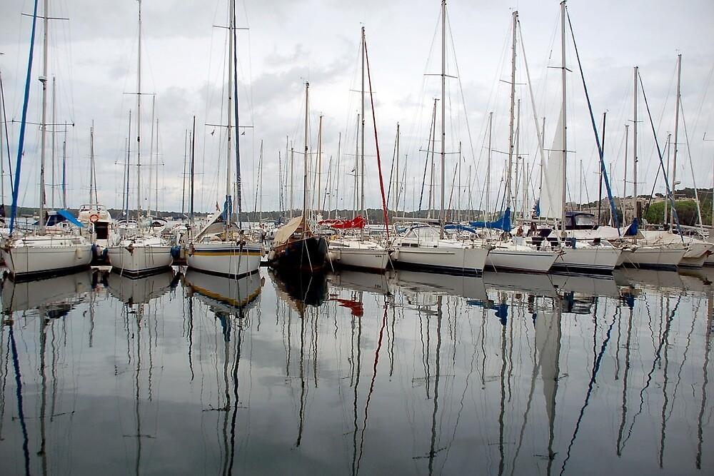 Reflections in the marina of Pula- Croatia by Arie Koene