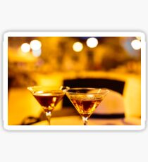 Martini glass on a table Sticker