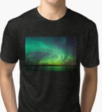 Northern lights over lake in Finland Tri-blend T-Shirt
