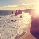Twelve Apostles with Sun Flare Port Campbell National Park Australia by Beverly Claire Kaiya