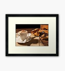 Close-up of coffee cup, dried orange fruit and cinnamon sticks Framed Print
