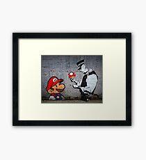 Banksy - Policeman and Mario's mushroom Framed Print