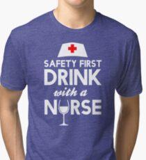 Safety first drink with a nurse Tri-blend T-Shirt