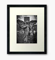 Angel on a Cross Framed Print