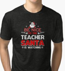 Funny Christmas - Be Nice To Your Teacher Santa Is Watching Tri-blend T-Shirt