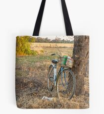 Sitting under the tree reading my books..... Tote Bag
