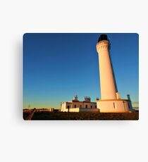 Sunrise over Covesea Skerries Lighthouse, Lossiemouth, Scotland. Canvas Print