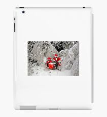 Santa Claus riding a motorcycle in a snow forest iPad Case/Skin