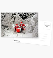 Santa Claus riding a motorcycle in a snow forest Postcards