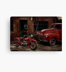 Indian 101 Scout and Chevy truck at a garage Canvas Print