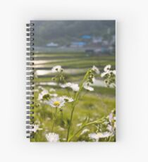 Wildflowers and a village in South Korea Spiral Notebook