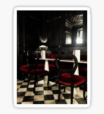 A touch of elegance with red velvet chairs in a darkened room Sticker