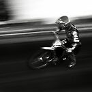 Speedway - into the first corner by Richard Flint