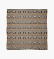 Entzückende junge Ziegen auf strukturiertem Hintergrund in den Braunen Tuch