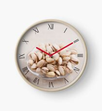 Pistachio nuts in shells lying Clock