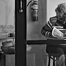 reading the papers and a cuppa by geof