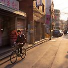 Boy Riding a Bike by koreanrooftop