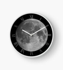Full moon on black sky background Clock