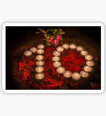 High Angle View Of Tea Light Candles Arranged In Number 10 Shape Sticker