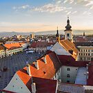 Romania. Transylvania. Sibiu. View from the top of the Clock Tower at Sunset. by vadim19