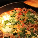 Pan food with meat, eggs, and vegetables. by naturematters