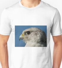 Close-up of gyrfalcon head with blue sky Unisex T-Shirt