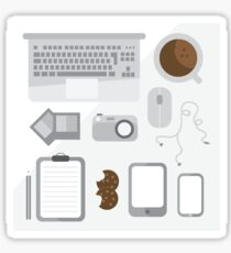 Geek illustration. Things left on the desk in order: coffee, laptop, tablet, smartphone, camera, mouse, headphones, cookies, notepad, pencil and photos. Gray colors Sticker