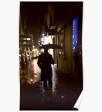 Man walking in street at night in rain color 35mm analogue photojournalism portrait photograph Poster
