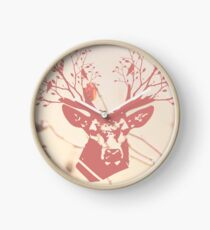 The deer head. Deer horns with flowers and birds. Beige and pink background Clock