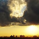 Sunset clouds over New York City  by Alberto  DeJesus