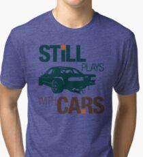 Still plays with cars (7) Tri-blend T-Shirt
