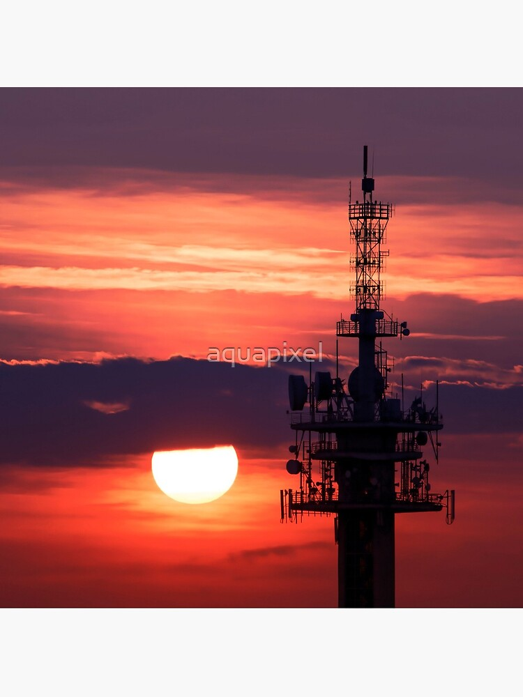 Steel tower with antennas with the beautiful red sunset as a background by aquapixel