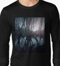 Gloomy swamp. Reflection of trees in water. Sunset landscape T-Shirt