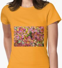 Background of bright red and yellow leaves of a bush Womens Fitted T-Shirt