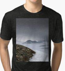 Dark mountain landscape. Snowy mountains in the deep fog. No Man's land Tri-blend T-Shirt