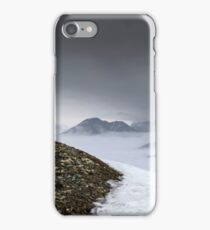 Dark mountain landscape. Snowy mountains in the deep fog. No Man's land iPhone Case/Skin