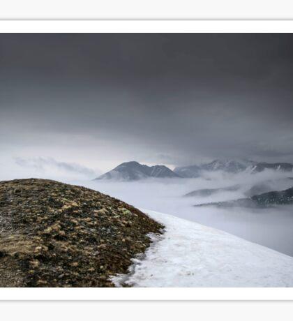 Dark mountain landscape. Snowy mountains in the deep fog. No Man's land Sticker