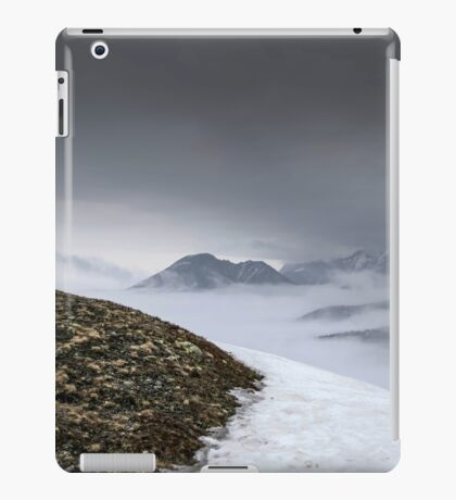 Dark mountain landscape. Snowy mountains in the deep fog. No Man's land iPad Case/Skin