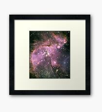 Young stars scuplt gas with powerful outflows Framed Print