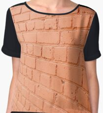 Angle view of a brick wall with a layer of red paint Women's Chiffon Top