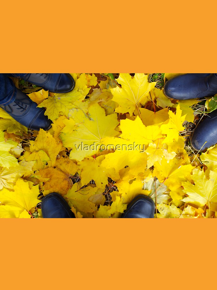 Overhead view of a foot in the autumn boots three people by vladromensky