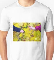 Hands of mother and daughter close-ups that hold the maple leaves Unisex T-Shirt