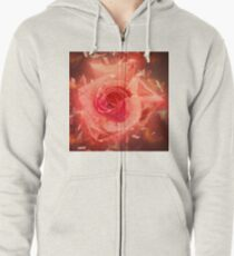 Digitally enhanced orange rose flower with green foliage background  Zipped Hoodie