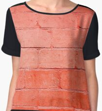 Red background of bricks with a layer of paint closeup Women's Chiffon Top