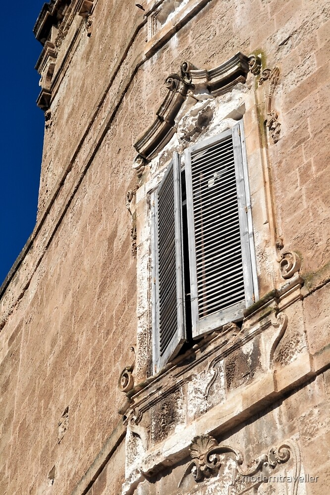 Traditional shutters in a painted wall, Puglia by moderntraveller