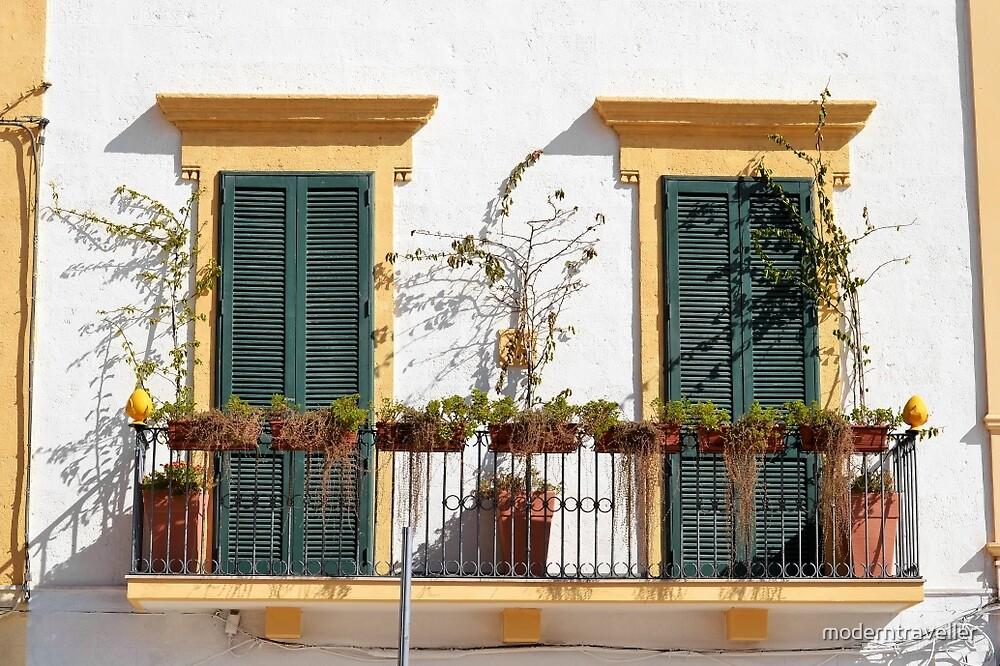 Bright balcony, beautiful shutters - Puglia by moderntraveller
