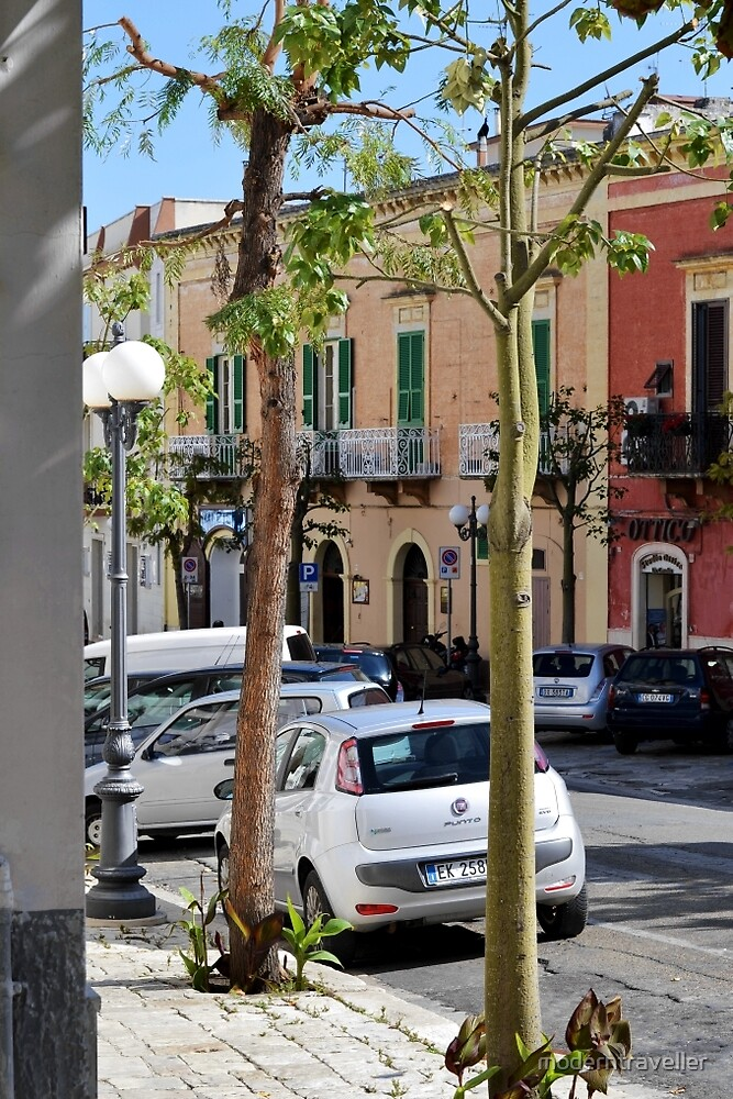 Bright buildings on Puglia street by moderntraveller