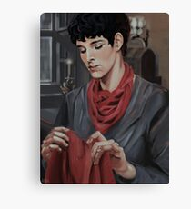 Merlin sewing Arthur's red shirt Canvas Print