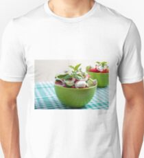Green bowl with vegetable salad  on a green checkered tablecloth T-Shirt