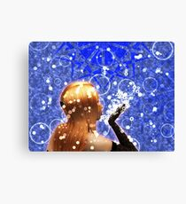 Blond girl is blowing snowflakes Canvas Print